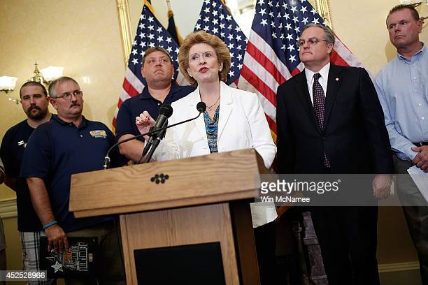S Sen Debbie Stabenow joined by workers from the UAW and the United Steelworkers speaks at a press conference about the 'Bring Jobs Home Act' as US...