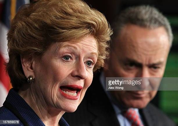 S Sen Debbie Stabenow speaks as Sen Charles Schumer listens during a news conference December 5 2012 on Capitol Hill in Washington DC The senators...