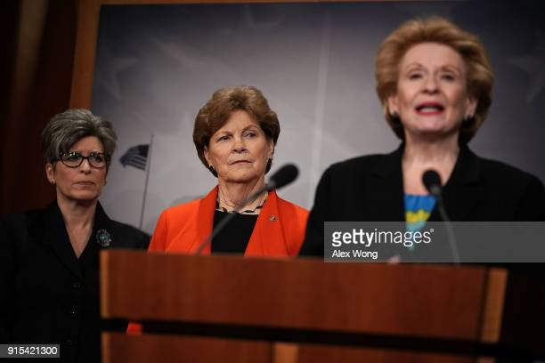 S Sen Debbie Stabenow speaks as Sen Joni Ernst and Sen Jeanne Shaheen listen during a news conference at the Capitol February 7 2018 in Washington DC...