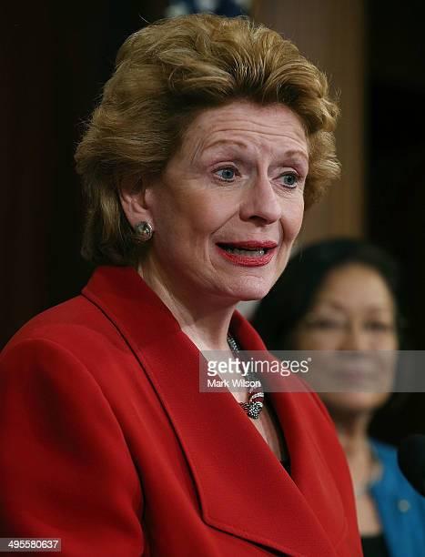 Sen Debbie Stabenow speaks student loans for women during a news conference on Capitol Hill June 4 2014 in Washington DC Democratic women Senators...