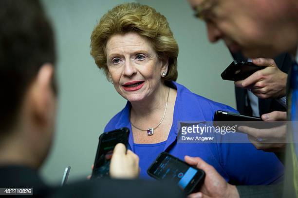 Sen Debbie Stabenow talks to reporters in the basement of the Capitol on her way to a meeting with Senate Democrats on Capitol Hill July 28 2015 in...