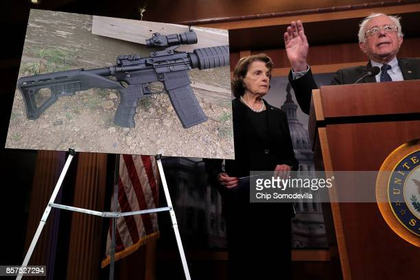 Sen Dianne Feinstein and Sen Bernie Sanders hold a news conference to announce proposed gun control legislation at the US Capitol October 4 2017 in...