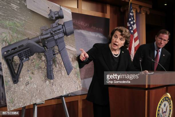 Sen Dianne Feinstein and Sen Richard Blumenthal points to a photograph of a rifle with a 'bump stock' during a news conference to announce proposed...