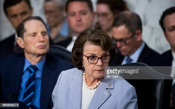 Sen Dianne Feinstein DCalif and Sen Ron Wyden DOre listen as Republicans members question former FBI Director James Comey during the Senate Select...