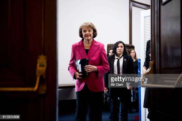 Sen Dianne Feinstein DCalif followed by Olympic gymnasts Jeanette Antolin and Jamie Dantzscher arrives for her press conference on her legislation to...