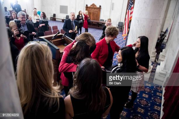 Sen Dianne Feinstein DCalif hugs Olympic gymnast Jamie Dantzscher as Rep Susan Brooks RInd speaks with Olympic gymnast Dominique Moceanu right at the...