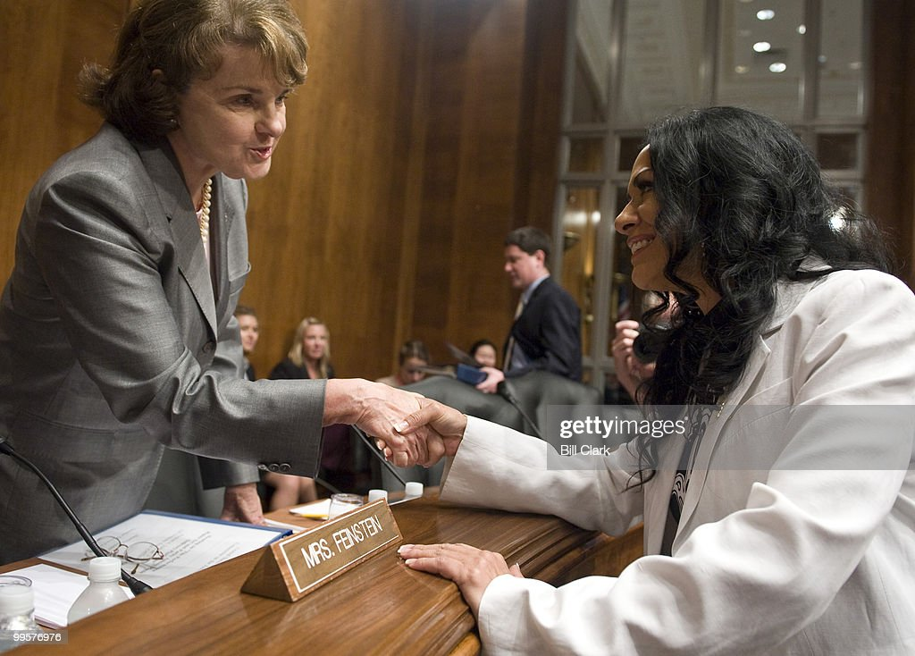 Sen. Dianne Feinstein, D-Calif., shakes hands with Grammy Award-nominated artist Sheila E, representing the MusicFIRST Coalition, before the start of the Senate Judiciary Committee full committee hearing on 'The Performance Rights Act and Parity among Music Delivery Platforms' on Tuesday, Aug. 4, 2009.