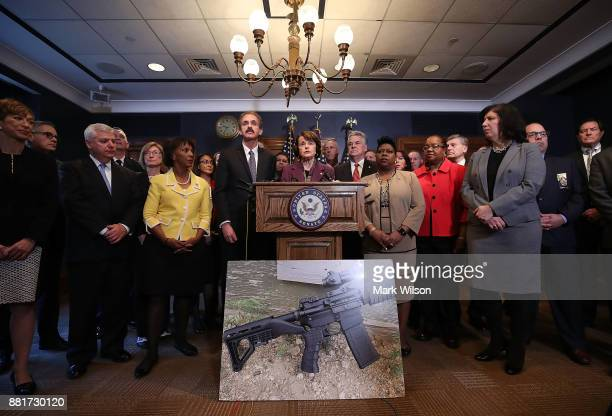 Sen Dianne Feinstein flanked by members of Congress and district attorneys from across the country speaks during a press conference about her...