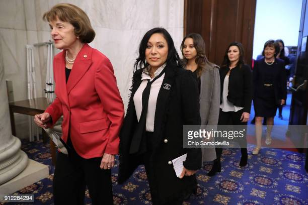 Sen Dianne Feinstein former gymnasts Jeanette Antolin Mattie Larson and Jamie Dantzscher and Sen Susan Collins arrive for a news conference about...