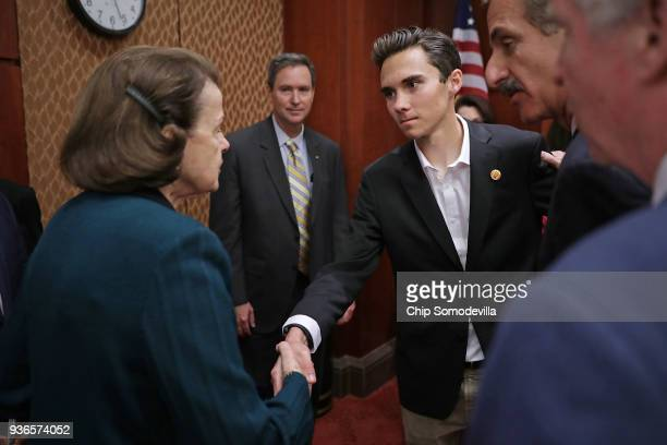 Sen Dianne Feinstein greets Marjory Stoneman Douglas High School shooting survivor David Hogg ahead of a news conference in the US Capitol Visitors...