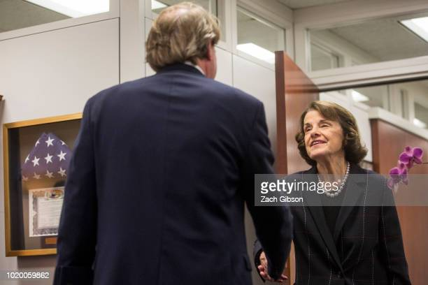 Sen Dianne Feinstein greets White House Counsel Don McGahn before her meeting with Supreme Court Justice nominee Judge Brett Kavanaugh on Capitol...