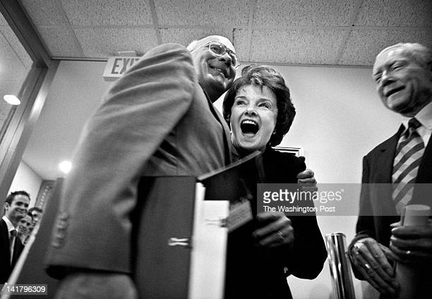 Sen Dianne Feinstein is embraced by Sen Patrick J Leahy left before an Amber Alert press conference outside the doors of the Senate Radio and TV...