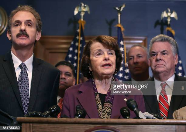 Sen Dianne Feinstein is flanked by Rep Peter King and Los Angeles City Attorney Mike Feuer while she expresses her opposition to a bill the House...