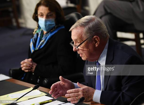Sen. Dianne Feinstein listens when Sen. Dick Durbin speaks as Judge Amy Coney Barrett appears before the Senate Judiciary Committee on day three of...
