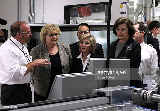 US Sen Dianne Feinstein Sen Barbara Boxer and US Rep Zoe Lofgren look on as Stion CEO Chet Ferris leads them on a tour of the Stion production...