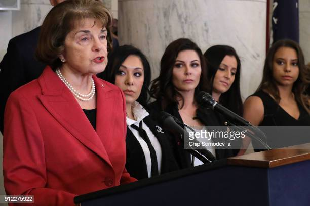 Sen Dianne Feinstein speaks during a news conference to discuss new legislation to protect athletes with gymnasts Dominique Moceanu Jeanette Antolin...