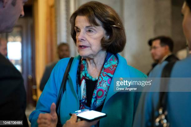Sen Dianne Feinstein talks to reporters as she exits the Senate floor following the Senate's confirmation of the nomination of Judge Brett Kavanaugh...