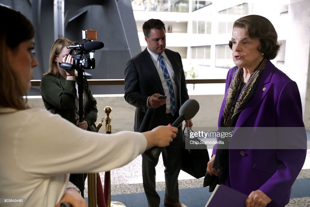 Sen. Dianne Feinstein (D-CA) (R) talks to reporters before heading into a closed-door meeing of the Senate Intelligence Committee in the Hart Senate Office Building on Capitol Hill July 27, 2017 in Washington, DC. The committee is continuing its investigation into Russian meddling in the 2016 presidential election.