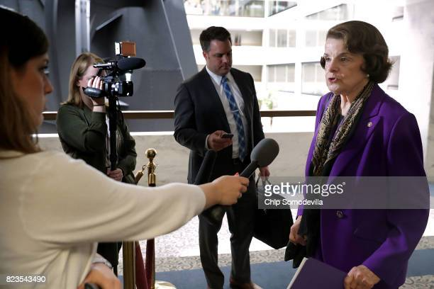 Sen Dianne Feinstein talks to reporters before heading into a closeddoor meeing of the Senate Intelligence Committee in the Hart Senate Office...