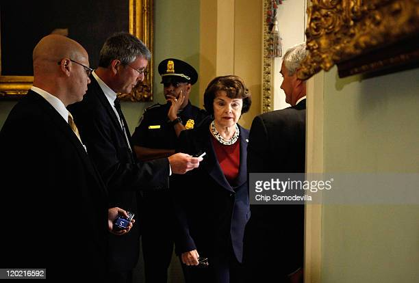 Sen Dianne Feinstein talks with a reporter before meeting with US Vice President Joe Biden and the Senate Democratic caucus at the US Capitol August...
