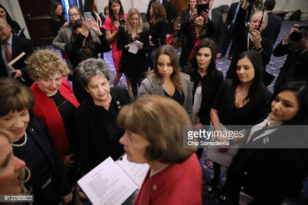 Sen Dianne Feinstein talks with fellow members of Congress and former champion gymnasts before a news conference about legislation to protect...