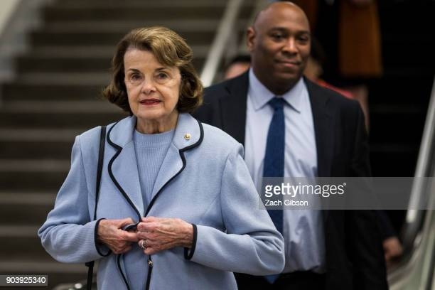 Sen Dianne Feinstein walks through the senate basement following a vote on Capitol Hill on January 11 2018 in Washington DC The house voted to...