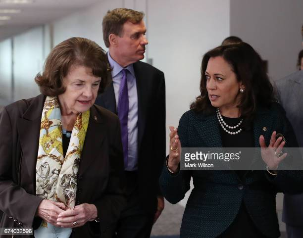 Sen Dianne Feinstein walks with Sen Kamala Harris and Sen Mark Warner to a Senate Select Committee on Intelligence closed door meeting at the US...