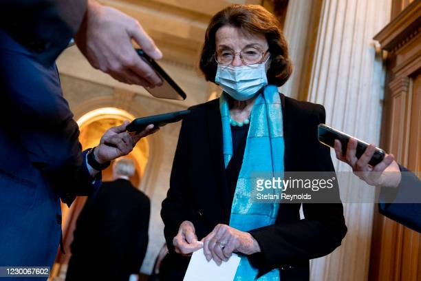 Sen. Dianne Feinstein wears a protective mask while speaking to reporters at the U.S. Capitol on December 11, 2020 in Washington, DC. Lawmakers are...