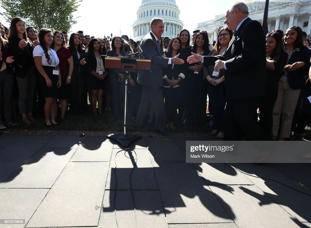 Sen. Dick Durbin (D-IL) (R) and Sen. Lindsey Graham (R-SC) (C) participate in a news conference with more than 100 recipients of the Deferred Action for Childhood Arrival program (DACA) to call on the Senate to support 'The DREAM Act.', on Capitol Hill October 4, 2017 in Washington, DC.
