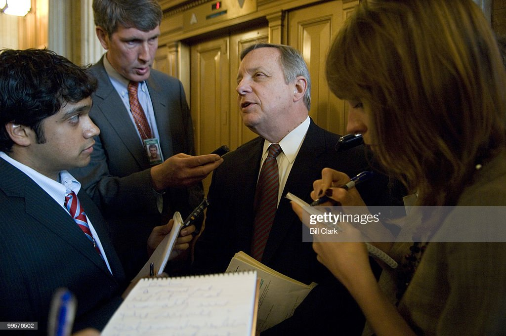 Sen. Dick Durbin, D-Ill., stops to speak with reporters as he heads to the weekly Senate Democratic Policy Committee luncheon in the Capitol on Tuesday, March 4, 2008.