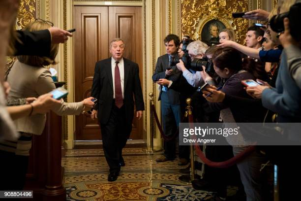 Sen Dick Durbin leaves a meeting with Senate Democrats on Capitol Hill January 22 2018 in Washington DC Lawmakers are continuing to seek a deal to...