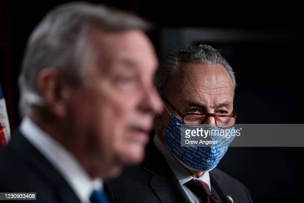 Sen. Dick Durbin speaks as Senate Majority Leader Chuck Schumer looks on during a press conference after a meeting with Senate Democrats at the U.S....