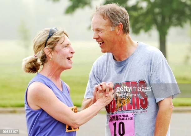 Sen. Don Nickles, R-Okla., congratulates Baltimore Sun writer Karen Hosler after the Capital Challenge 3 mile run in Anancostia Park, Wednesday...