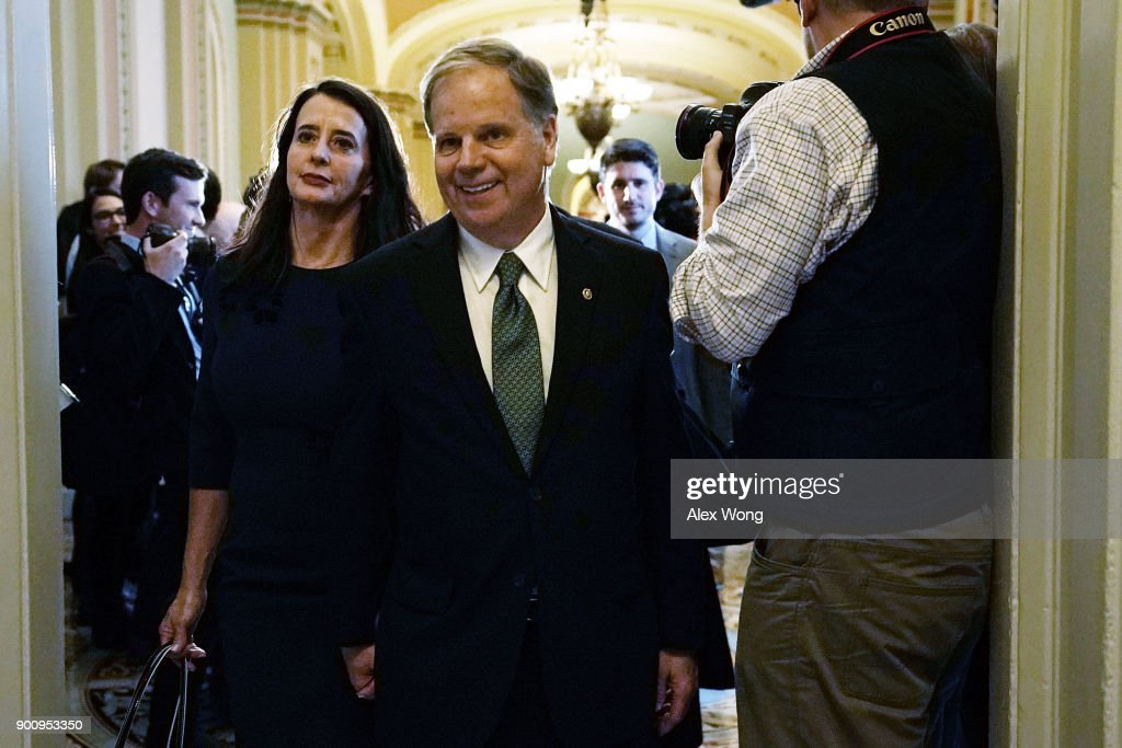 U.S. Sen. Doug Jones (D-AL) and his wife Louise arrive for a meeting with Senate Minority Leader Sen. Chuck Schumer (D-NY) at the U.S. Capitol January 3, 2018 in Washington, DC. Sen. Tina Smith (D-MN), the other newly sworn-in Democratic Senator, also attended the meeting.
