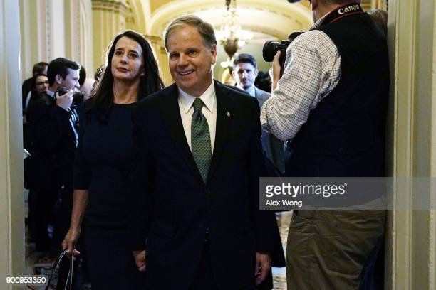 S Sen Doug Jones and his wife Louise arrive for a meeting with Senate Minority Leader Sen Chuck Schumer at the US Capitol January 3 2018 in...