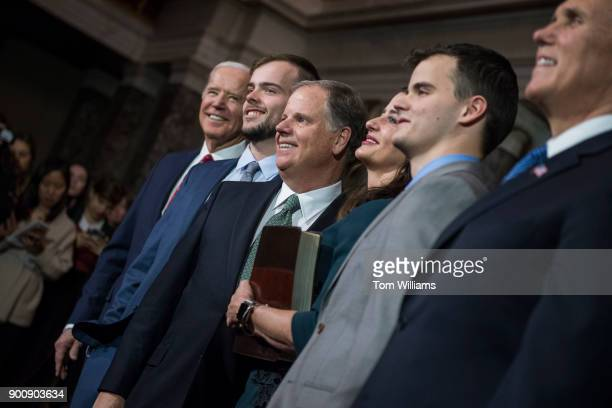 Sen Doug Jones DAla center poses for a picture after being administered an oath by Vice President Mike Pence far right during a swearingin ceremony...