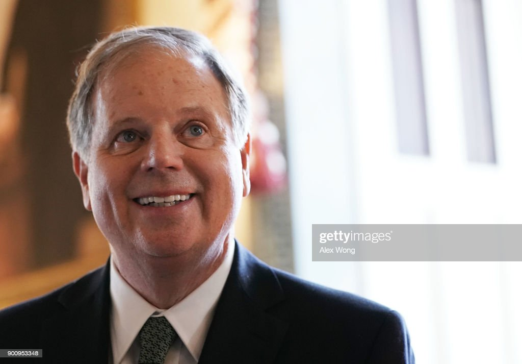 U.S. Sen. Doug Jones (D-AL) during a meeting with Senate Minority Leader Sen. Chuck Schumer (D-NY) at the U.S. Capitol January 3, 2018 in Washington, DC. Sen. Tina Smith (D-MN), the other newly sworn-in Democratic Senator, also attended the meeting.