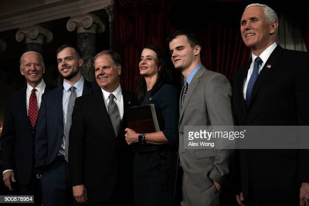 S Sen Doug Jones participates in a group photo with former Vice President Joseph Biden son Carson wife Louise son Christopher and Vice President Mike...