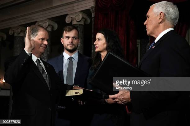 S Sen Doug Jones participates in a mock swearingin ceremony with Vice President Mike Pence as Jones' wife Louise and son Carson look on at the Old...