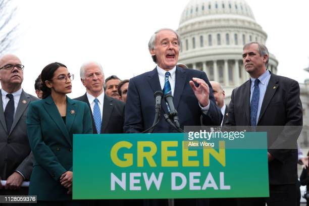 S Sen Ed Markey speaks as Rep Alexandria OcasioCortez and other Congressional Democrats listen during a news conference in front of the US Capitol...