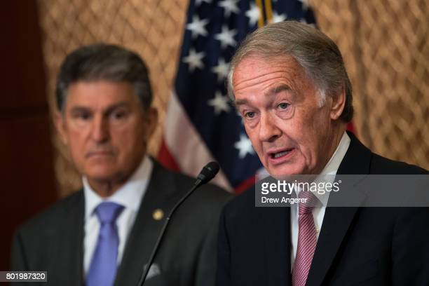 US Sen Ed Markey speaks as Sen Joe Manchin looks on during a news conference to discuss the national opioid crisis on Capitol Hill June 27 2017 in...
