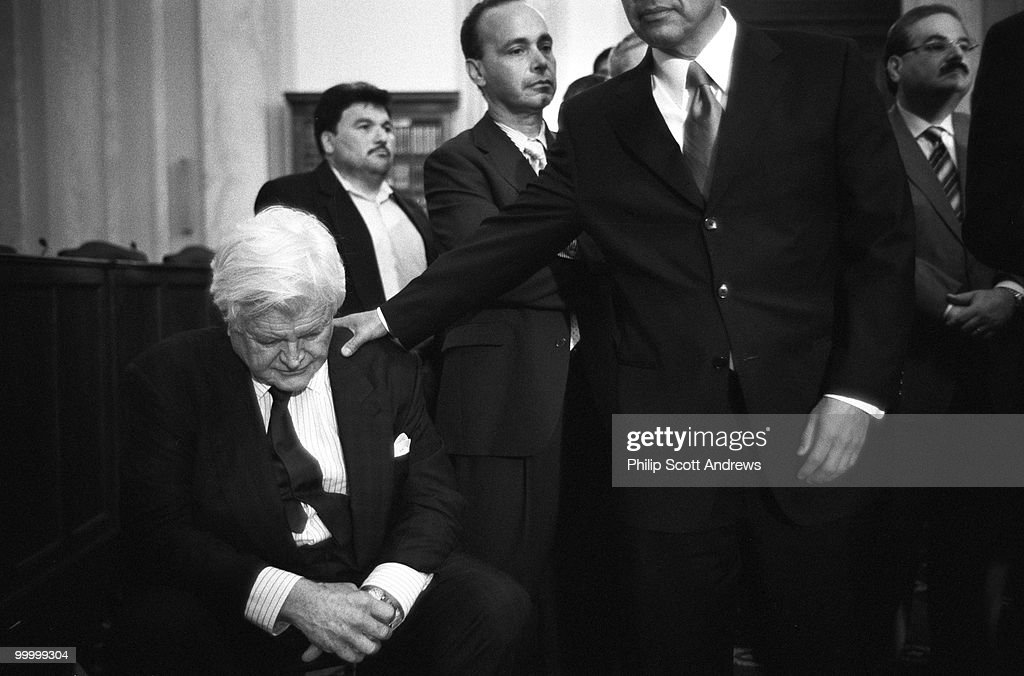 Sen. Edward Kennedy, D-Mass, is patted on the back during a press conference in which he tried to gain support for comprehensive immigration legislation. The Bill, which would have given an estimated 12.5 million illegal immigrants a path towards legality, was later defeated in the Senate.