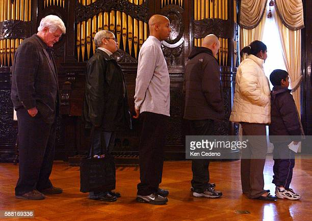 Sen Edward Kennedy DMass left waits in line to sign a condolence book for earthquake and flood victims at the Indonesia Embassy December 29 2004 in...