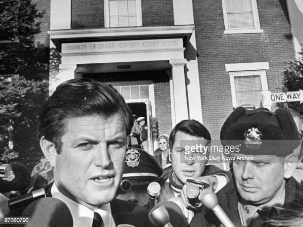 Sen Edward Kennedy talks to reporters after leaving courthouse in Edgartown Mass following inquest into the death of Mary Jo Kopechne who drowned...