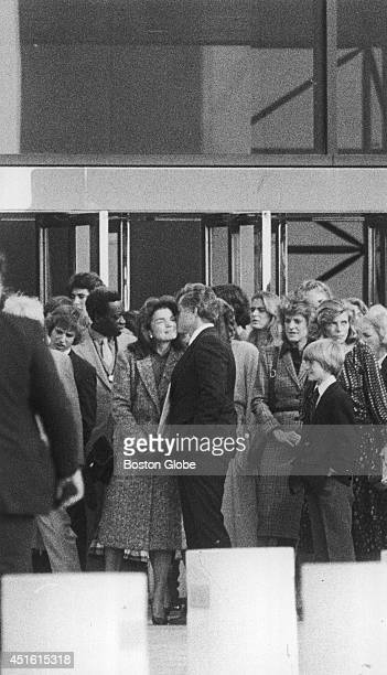 Sen Edward M Kennedy greets Jacqueline Kennedy Onassis with a kiss at the entrance to the John F Kennedy Library on October 20 1979