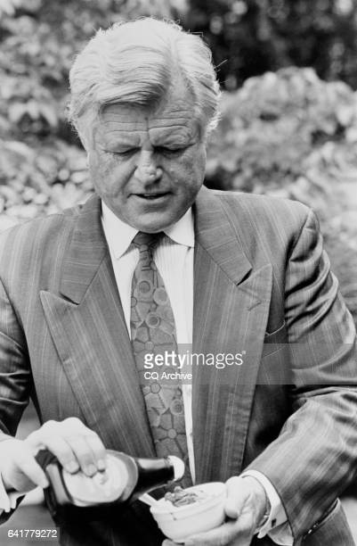 Sen Edward Moore 'Ted' Kennedy DMass adding some toppings to his ice cream June 20 1991
