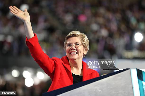 Sen. Elizabeth Warren acknowledges the crowd as she walks on stage to deliver remarks on the first day of the Democratic National Convention at the...