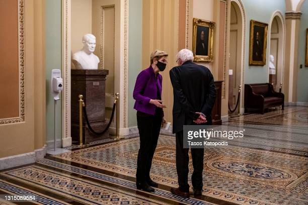Sen. Elizabeth Warren and Sen. Bernie Sanders chat after U.S. President Joe Biden spoke at a joint session of congress in the House chamber of the...