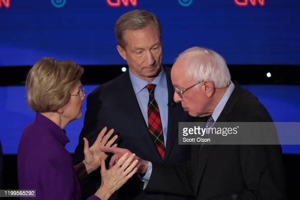 Sen. Elizabeth Warren and Sen. Bernie Sanders speak as Tom Steyer looks on after the Democratic presidential primary debate at Drake University on...