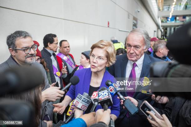 Sen Elizabeth Warren and Sen Ed Markey speak to reporters following a rally for airport workers affected by the government shutdown at Boston Logan...
